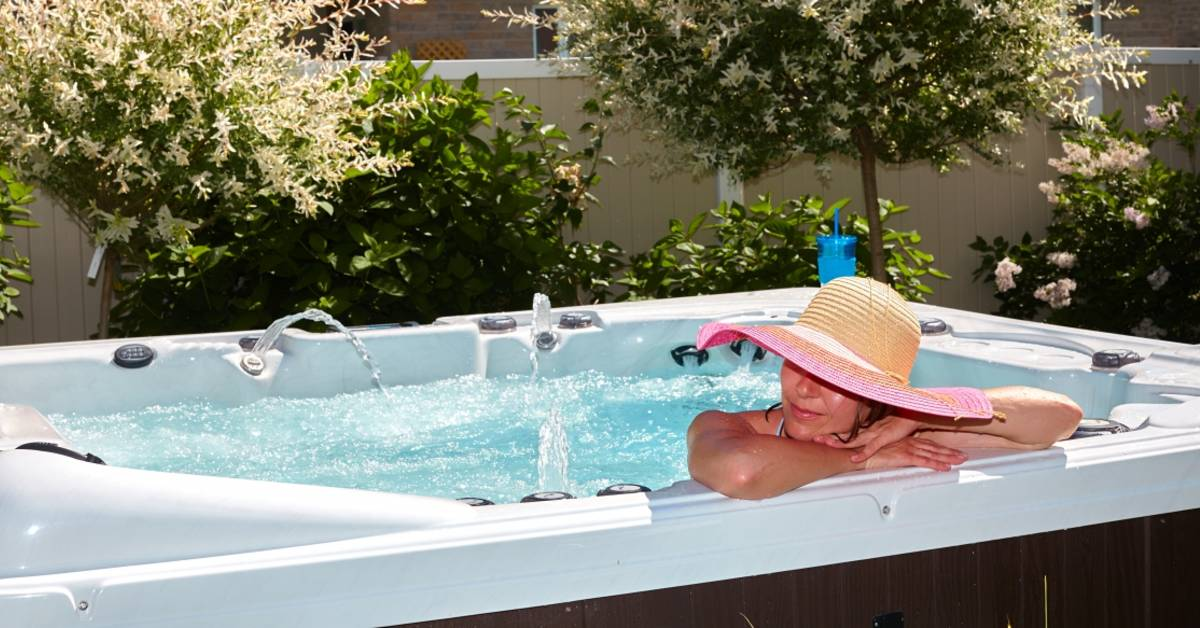 Woman lounging in a hot tub
